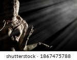 Small photo of Religious artifact. Bronze statue of Hindu Goddess Lakshmi. Hinduism in close up. Museum quality exhibit against black background with copy space.