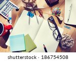 messy designer's table with... | Shutterstock . vector #186754508