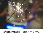 Small photo of A beautiful sparker with bokeh: 'Happy new year!' concept