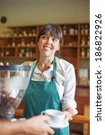 woman making coffee and giving... | Shutterstock . vector #186822926