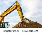 A Yellow Excavator Boom With A...