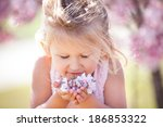 beautiful little girl in cherry ... | Shutterstock . vector #186853322