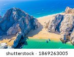 Small photo of Aerial view of Lovers Beach at Lands End, Cabo San Lucas, Mexico. The side facing the Sea of Cortez is named Lovers Beach while the side facing the Pacific Ocean is named Divorce Beach