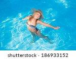young woman in bikini wearing a ... | Shutterstock . vector #186933152