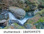 a stream and waterfall in the... | Shutterstock . vector #1869349375