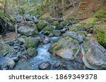a stream and waterfall in the... | Shutterstock . vector #1869349378