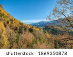 rocky mountains and autumnal... | Shutterstock . vector #1869350878