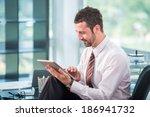 happy businessman in office... | Shutterstock . vector #186941732