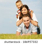 cheerful family on beautiful... | Shutterstock . vector #186957332