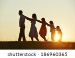 happy family silhouettes on... | Shutterstock . vector #186960365