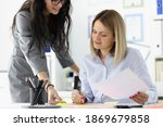 Small photo of Businesswoman brought documents for signature to boss. Signing and planning business ideas concept