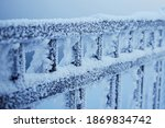 Metal Fence Covered With Snow...