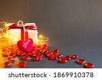 Red Hearts And A Gift Box On A...