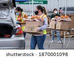 A Volunteer Loads Food Into The ...