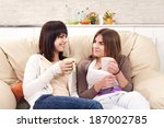 friends enjoy conversation | Shutterstock . vector #187002785