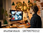 Virtual New Year 2021 meeting team teleworking. Family video call remote conference. Laptop webcam screen view. Team meet working from their home offices. Happy hour party online woman team diversity - stock photo