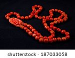 Red Coral Necklace On A Black...