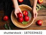 Woman Washing Ripe Red Apples...