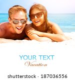 happy couple in sunglasses... | Shutterstock . vector #187036556