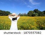 happy girl in a cosmos flower... | Shutterstock . vector #1870557082