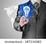 business man touching light of... | Shutterstock . vector #187114382