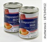 Small photo of Willard, Missouri - December 10, 2020: Evaporated milk. Bakers Corner canned evaporated milk is distributed by Aldi, Inc., Batavia, Illinois. Editorial.