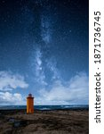 An Orange Lighthouse By The...
