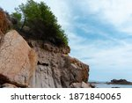 a cliff on the seaside  blue... | Shutterstock . vector #1871840065