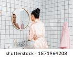 Young Woman In Satin Bathrobe...