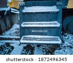 Snow Covered Steps Onto A...