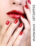 Macro of woman red lips and nails. Make-up and manicure. Beauty concept - stock photo