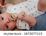 Baby With A Golden Cross On A...