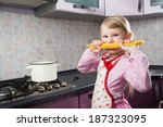 happy small girl with macaroni... | Shutterstock . vector #187323095