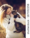 Stock photo young girl with cat on natural background 187352258