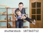 father trains the little son | Shutterstock . vector #187363712