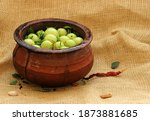 Fresh Gooseberries In Clay Pot. ...