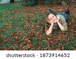 Teen Girl Lying On The Fallen...