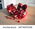 fresh ripe pomegranate on a... | Shutterstock . vector #1874693338