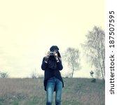 hipster girl walks in the... | Shutterstock . vector #187507595