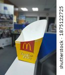 Small photo of KL, Malaysia - 15th December 2020 : An empty Mcdonald fries paper container. Empty Mc Donald twister fries box. McDonald's Twister Fries are a version of the McDonald's mcfries in curly form.