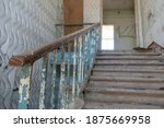 An Old Staircase In A Large...