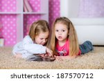 little kids playing on a tablet ...   Shutterstock . vector #187570712