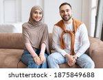 Cheerful Muslim Couple Sitting...