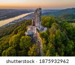 Panorama of the Rhine valley near Konigswinter  (Germany), with ruins of the medieval Drachenfels Castle in front and Bonn city in background, photographed at sunset, late summer, aerial photo