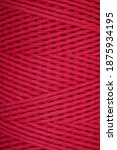 Small photo of Weave pattern of macrame red cord wind on spool