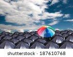 leader holding red umbrella for ... | Shutterstock . vector #187610768