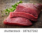 fresh raw meat on old wooden... | Shutterstock . vector #187627262