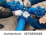 Workers Installing Water Supply ...