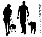 Stock vector vector silhouette of a people with a dog 187777106