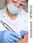 female dentist is drilling the... | Shutterstock . vector #18780112